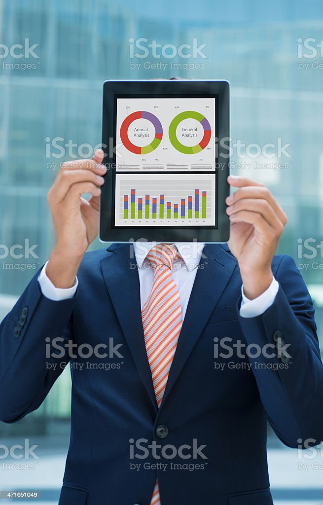 Businessman with tablet in front of his face stock photo