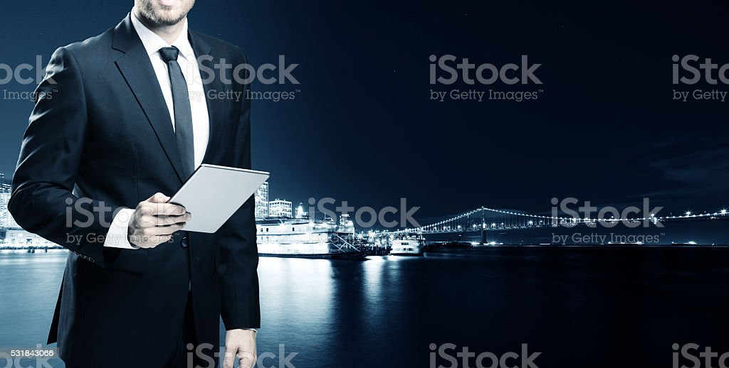 businessman with tablet with passenger liner  in san fra stock photo