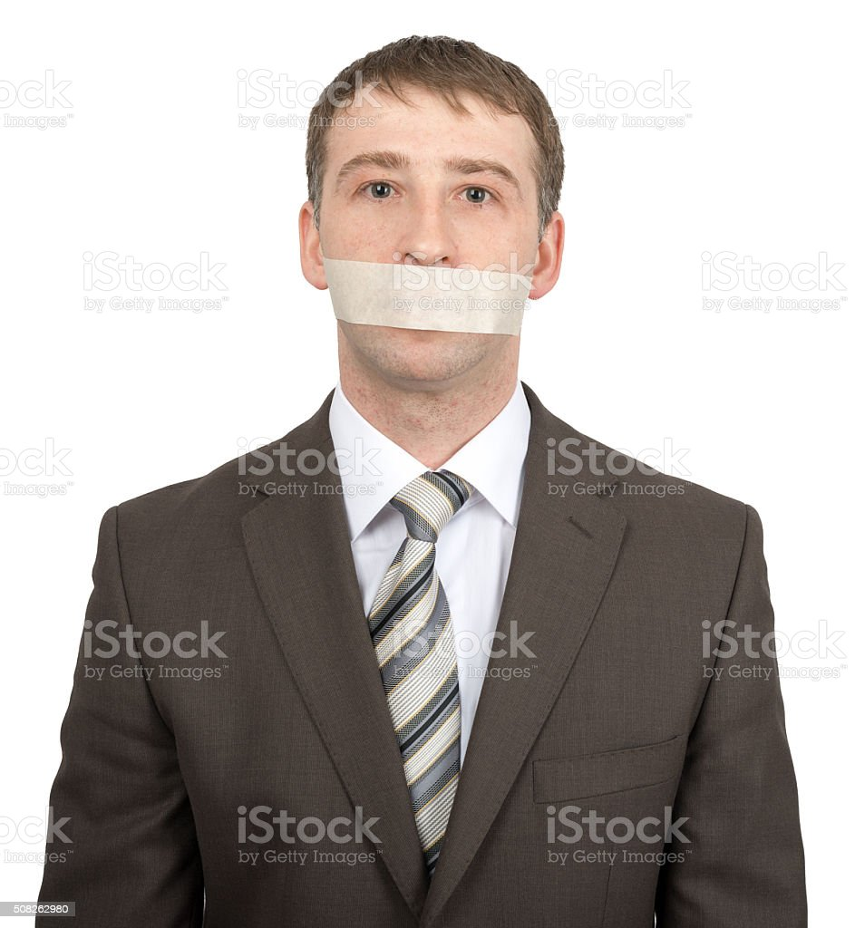 Businessman with tape over his mouth stock photo