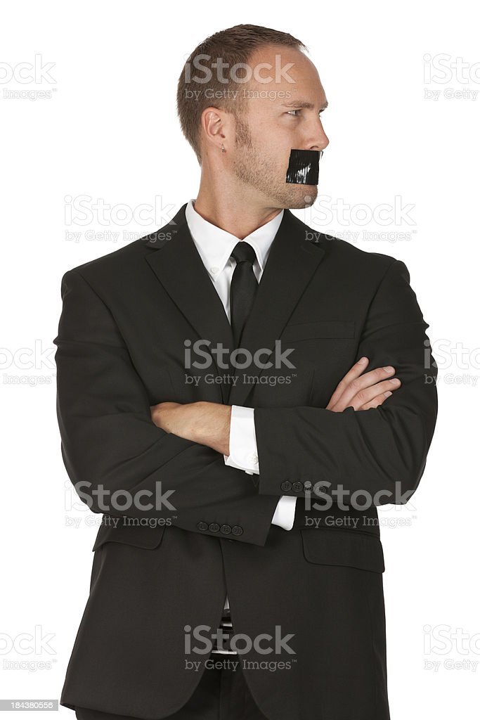Businessman with tape over mouth royalty-free stock photo