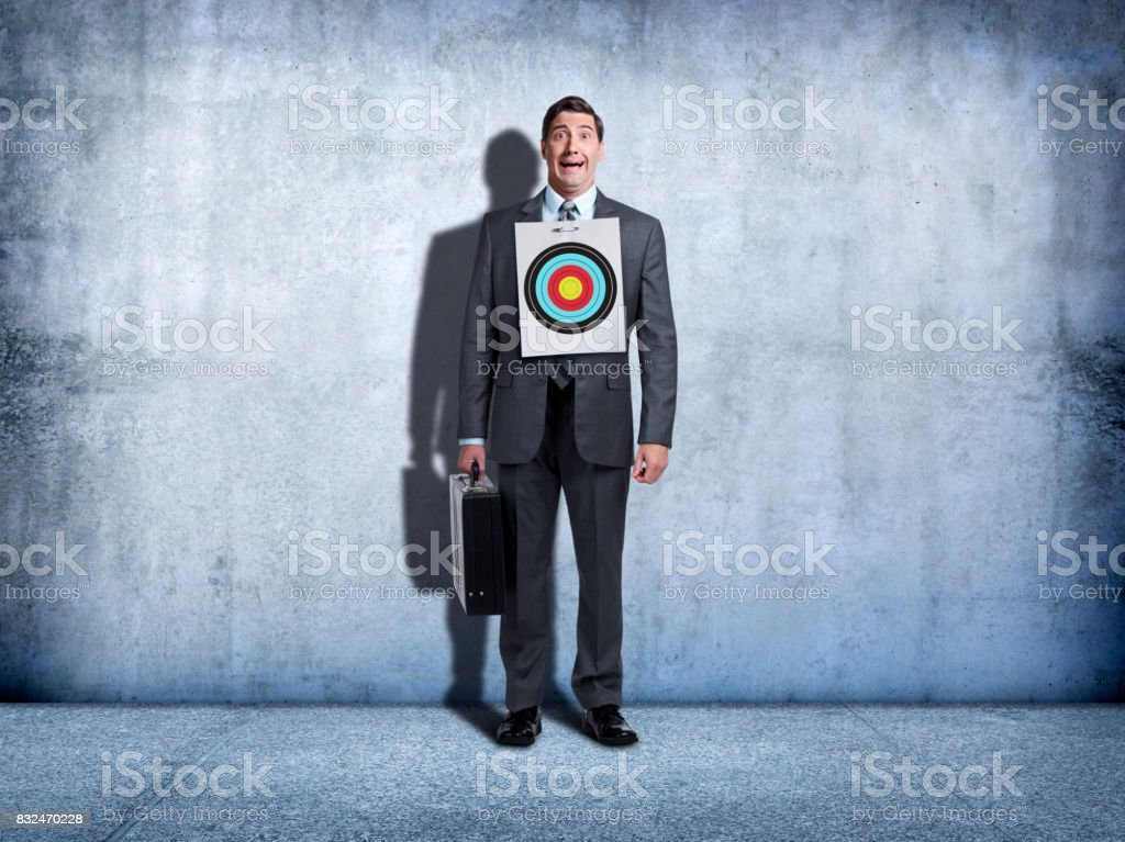 Businessman With Target Pinned To His Chest stock photo