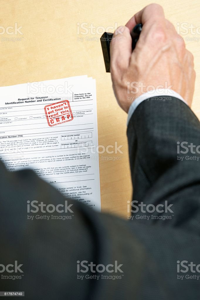 Businessman with tax document stock photo
