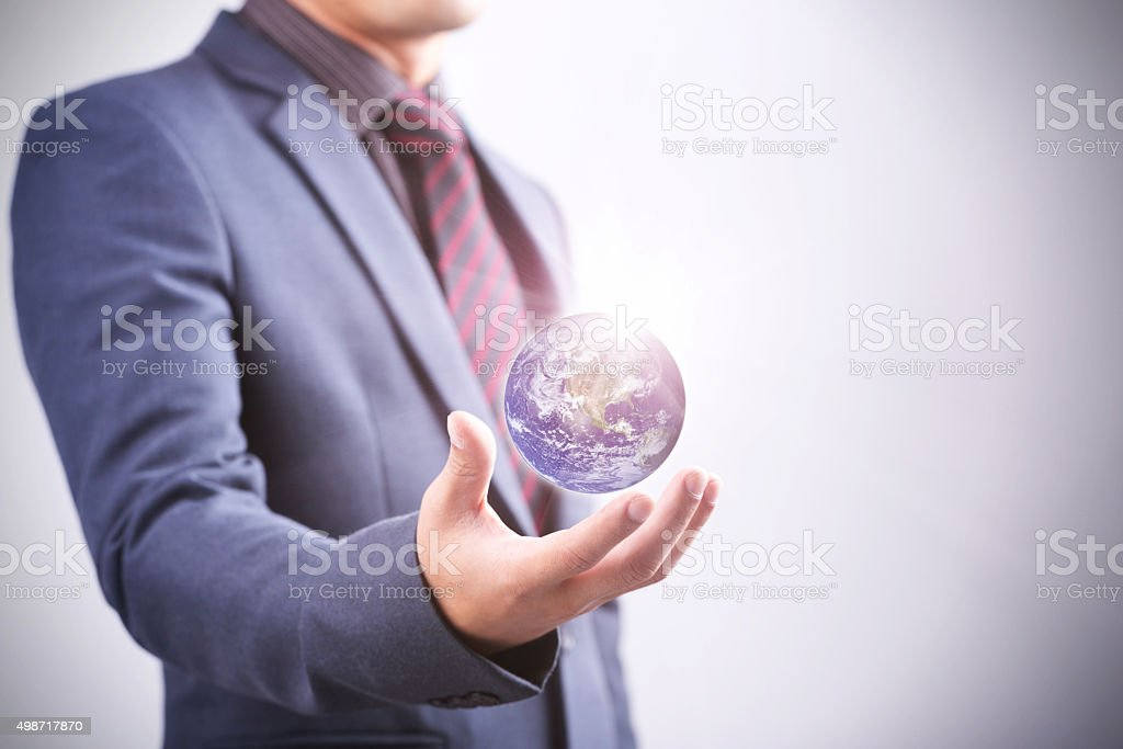 Businessman with the world in his hand stock photo