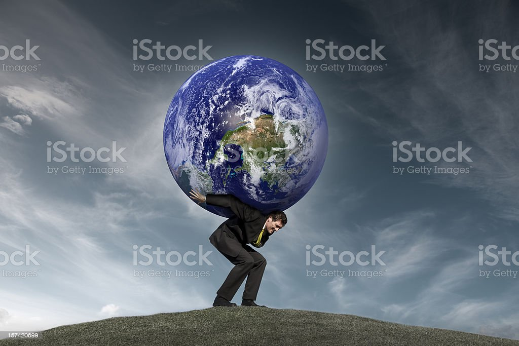Businessman with the World on his Shoulders stock photo