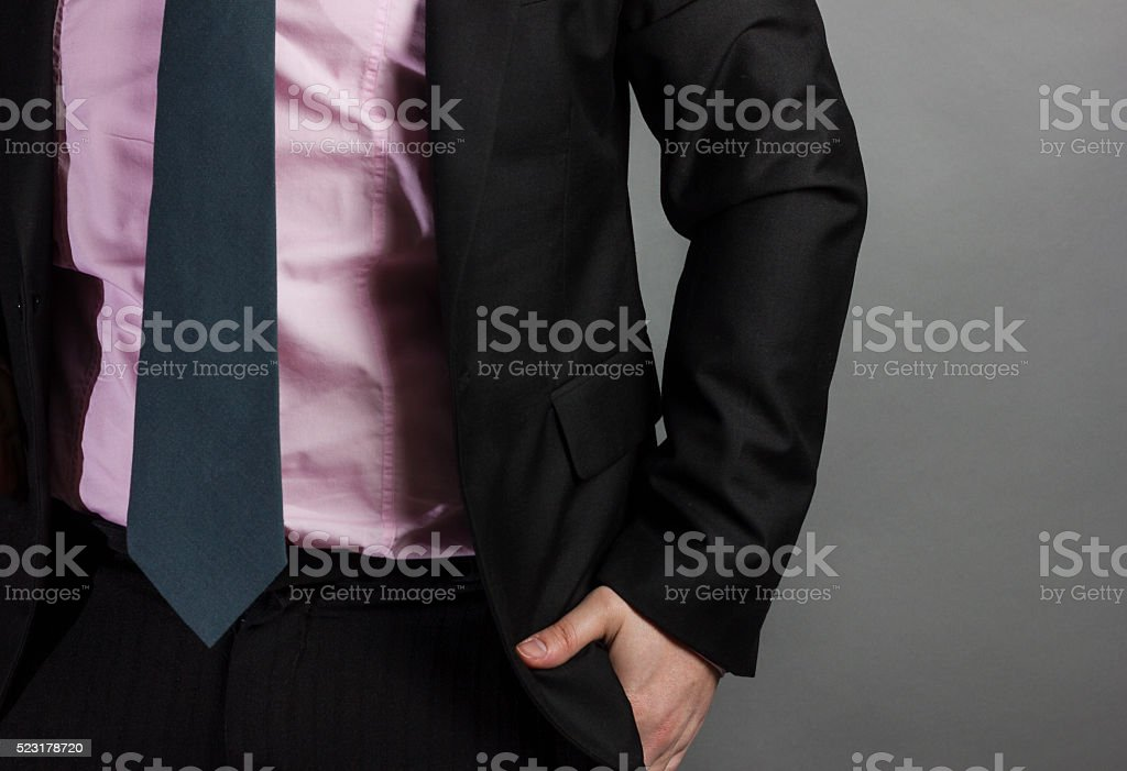 businessman with tie and suit insert hand stock photo