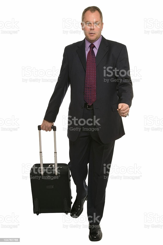 Businessman with travel luggage stock photo