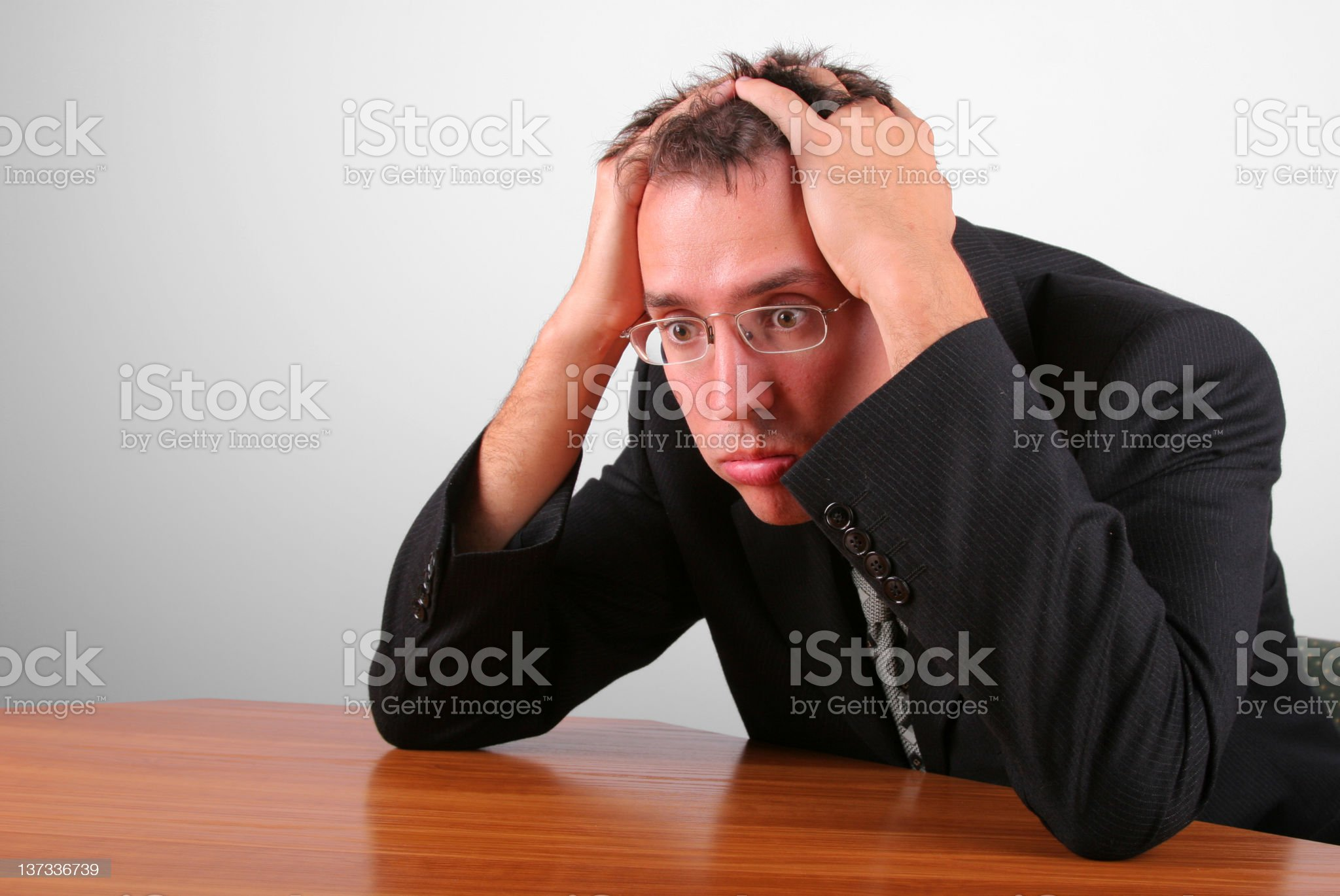 Businessman with troubled expression and hands on head royalty-free stock photo