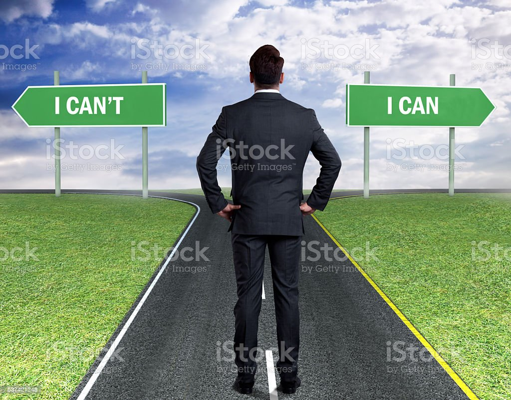Businessman with two choices - I Can't or I Can stock photo