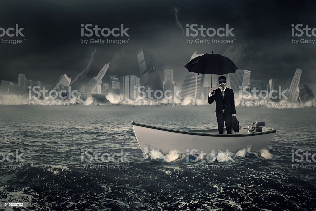 Businessman with umbrella in boat stock photo