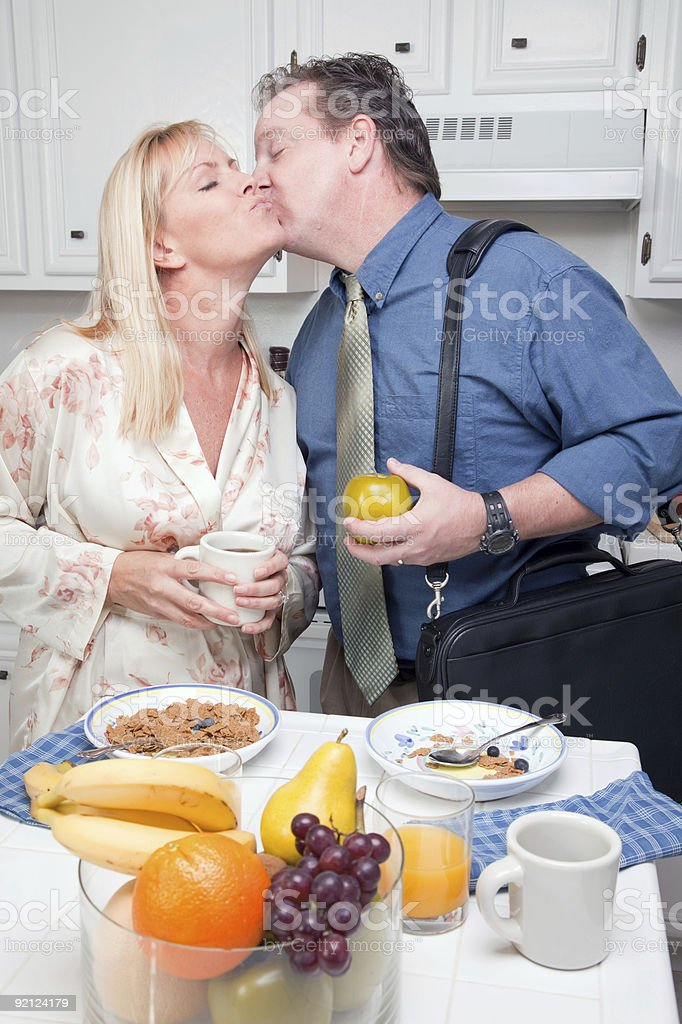 Businessman with Wife In Kitchen royalty-free stock photo