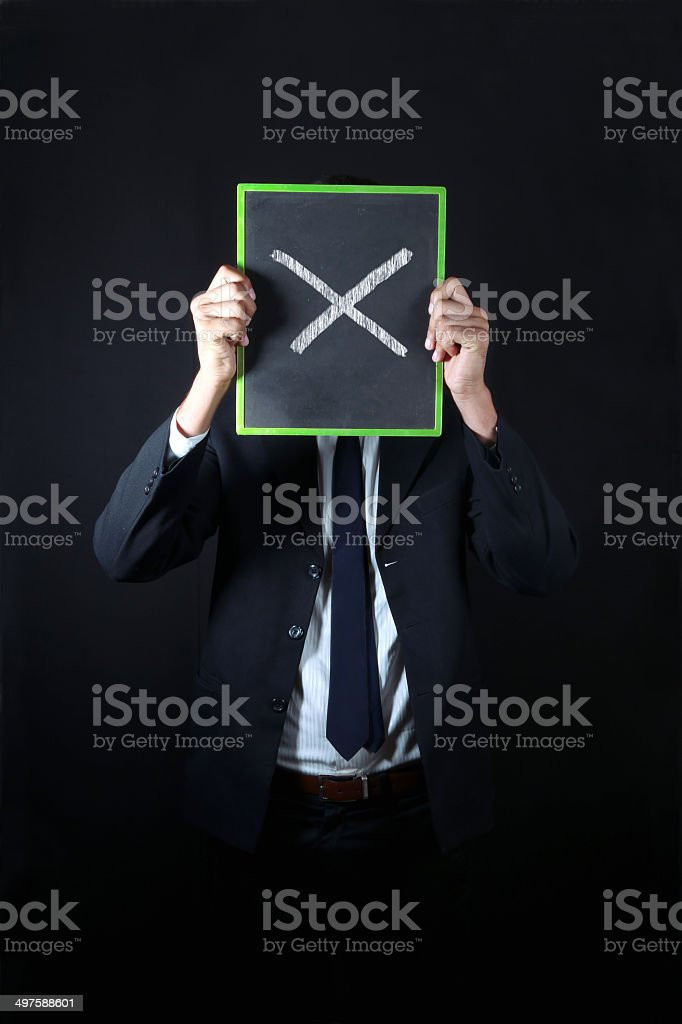 Businessman with wrong sign stock photo
