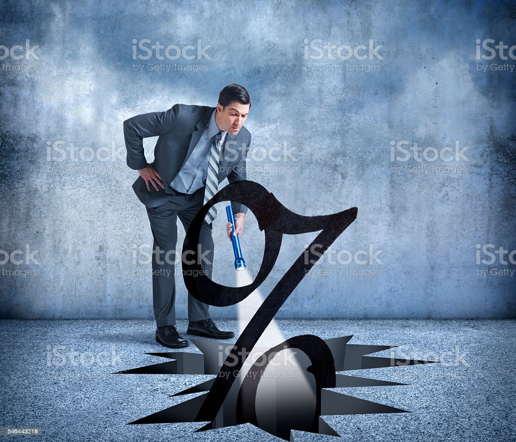 Businessman Wondering How Low Interest Rates Can Go stock photo