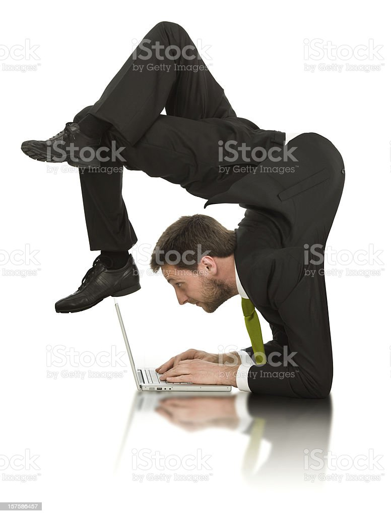 businessman work  contortion with laptop isolated on white stock photo