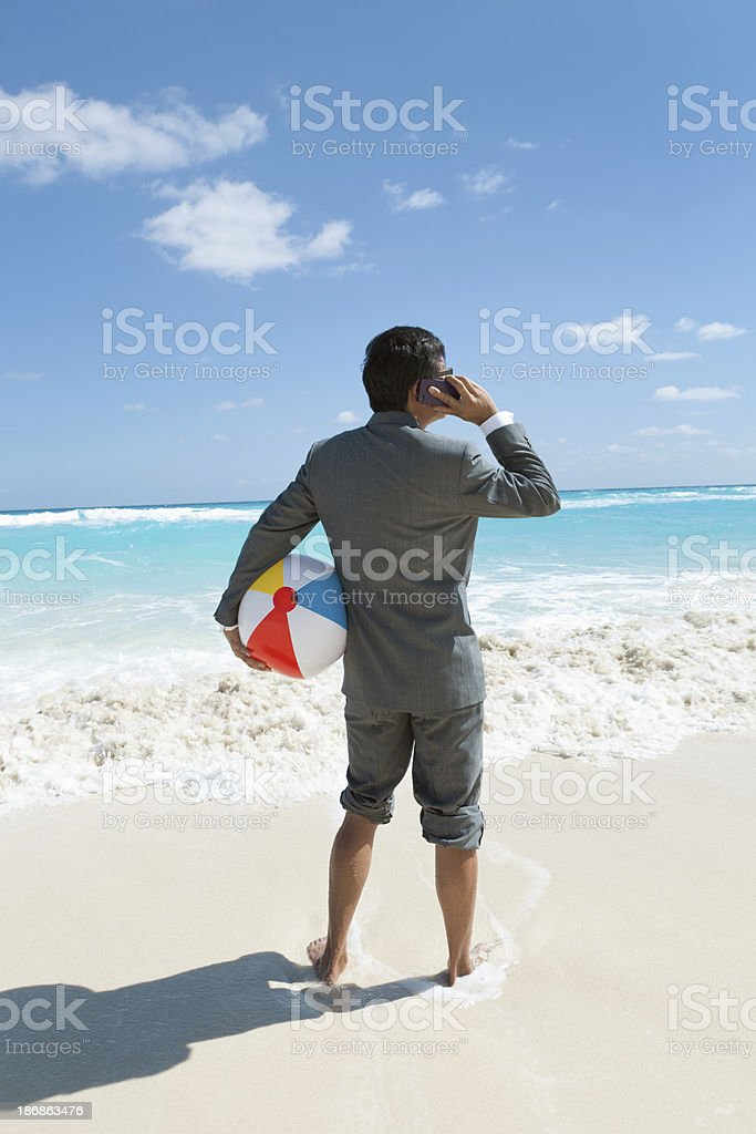 Businessman Working and Talking on Cell Phone While Vacation royalty-free stock photo