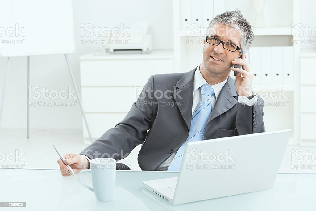 Businessman working at desk royalty-free stock photo
