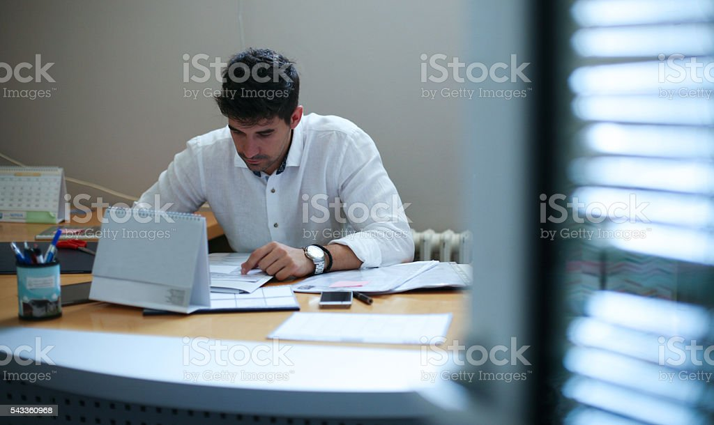 Businessman working at his desk. stock photo
