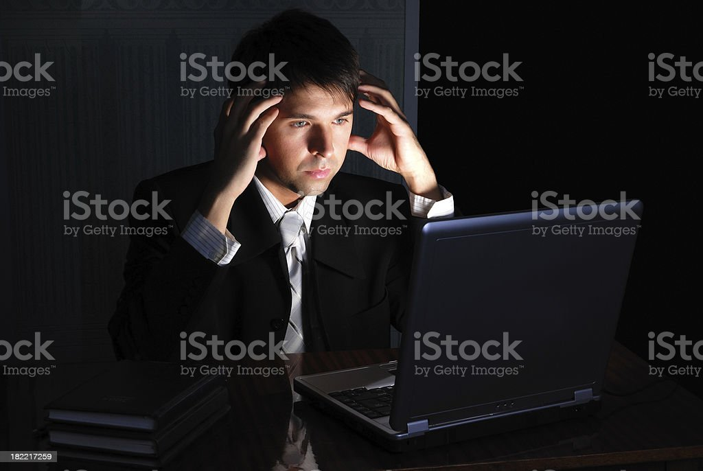 Businessman Working at Night royalty-free stock photo