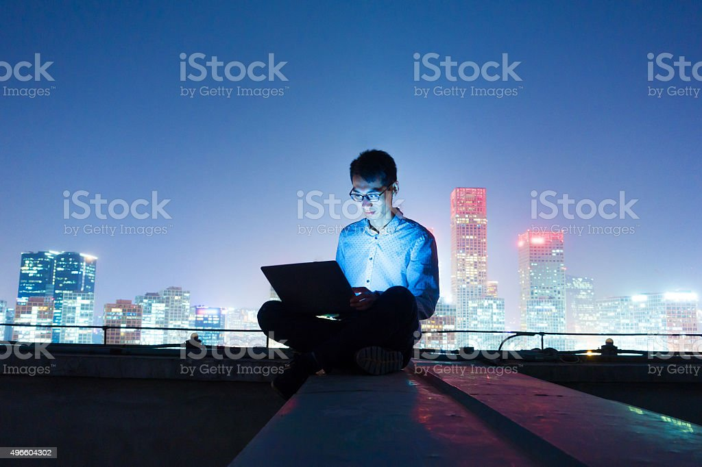 Businessman working at night stock photo