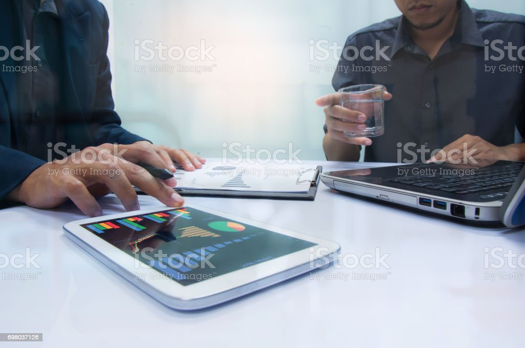 Businessman working at office. Digital tablet laptop computer smart phone using, keyboard. Connection internet application online. Finance manager. Banking. Professional investor. stock photo