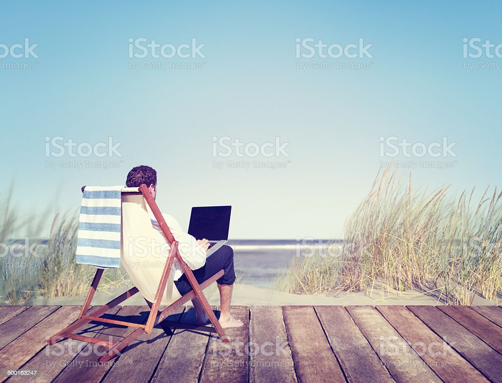 Businessman Working by the Beach stock photo