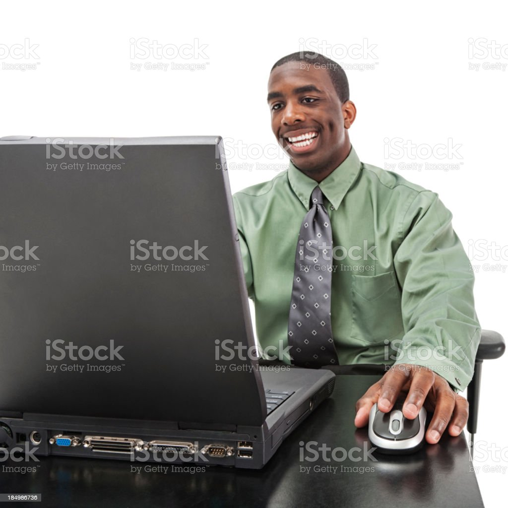Businessman Working Happily at Desk with Laptop Computer royalty-free stock photo