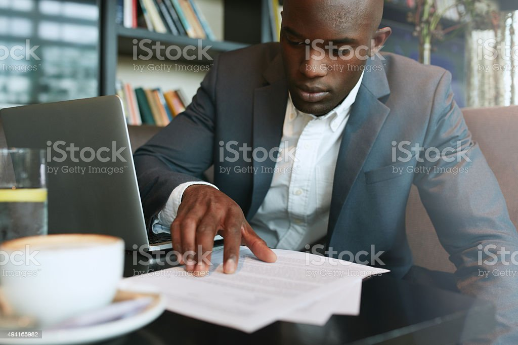 Businessman working in a coffee shop stock photo