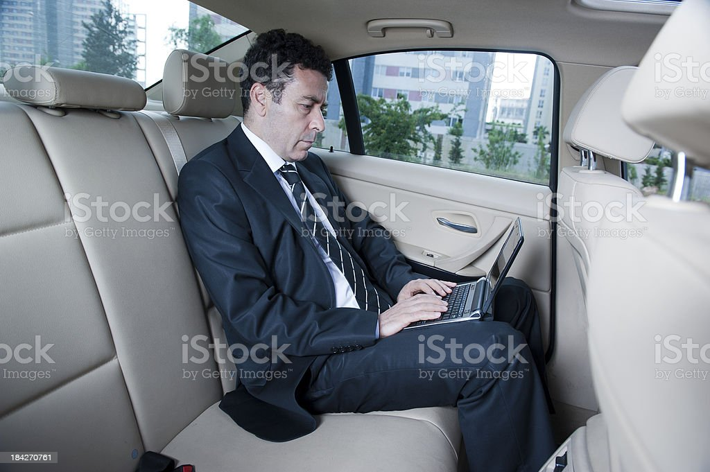 Businessman Working in Back of Car royalty-free stock photo