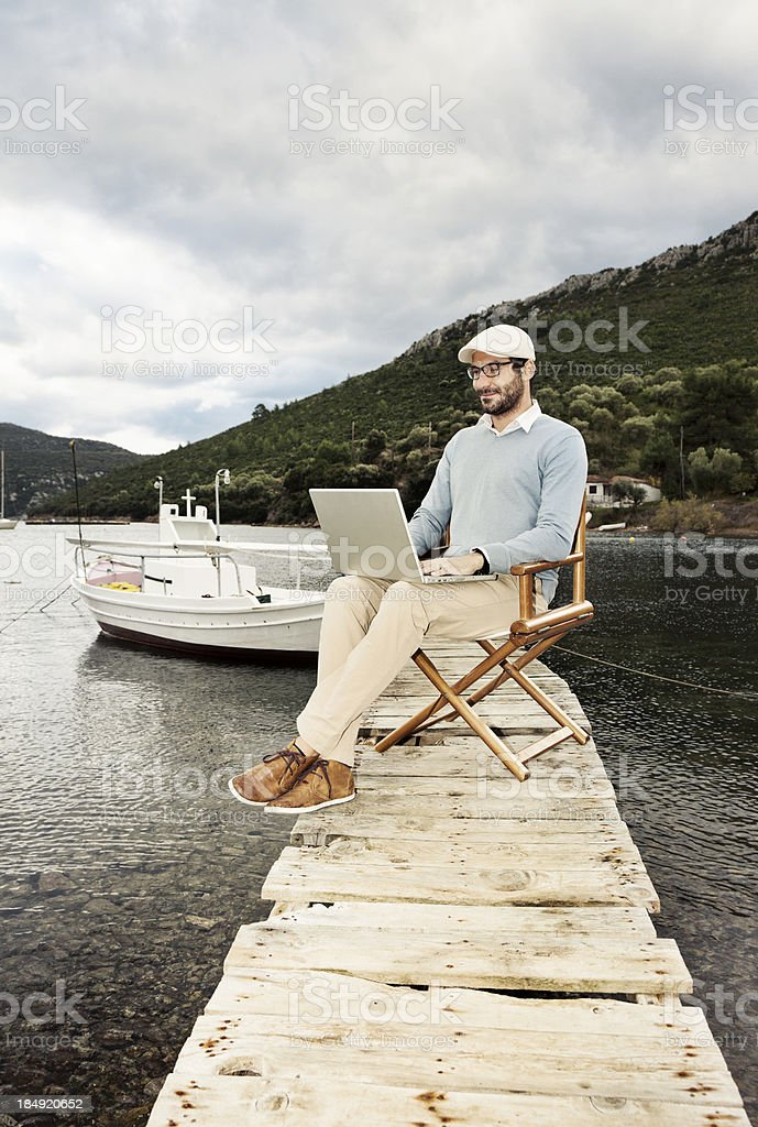 Businessman working in nature. Out of Office. royalty-free stock photo