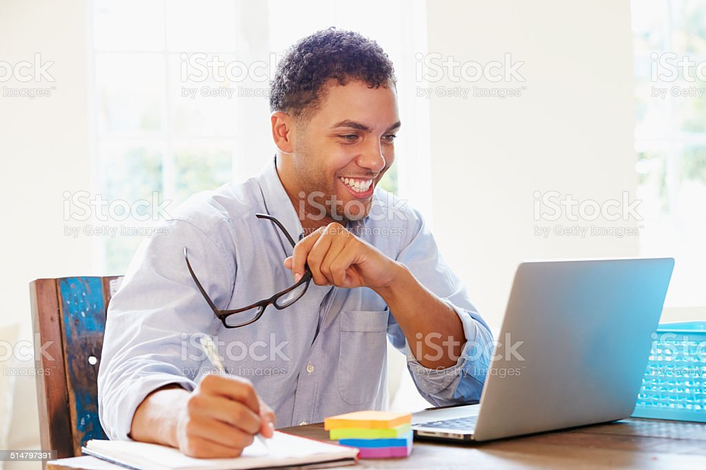 Businessman Working In Office At Home stock photo