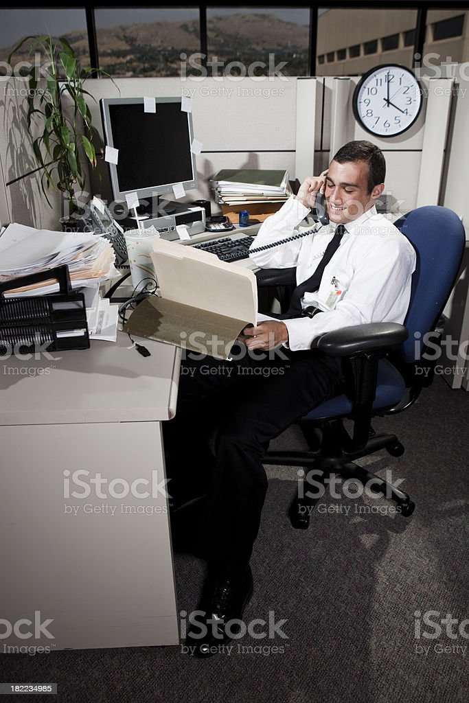 Businessman Working in Office Cubicle royalty-free stock photo
