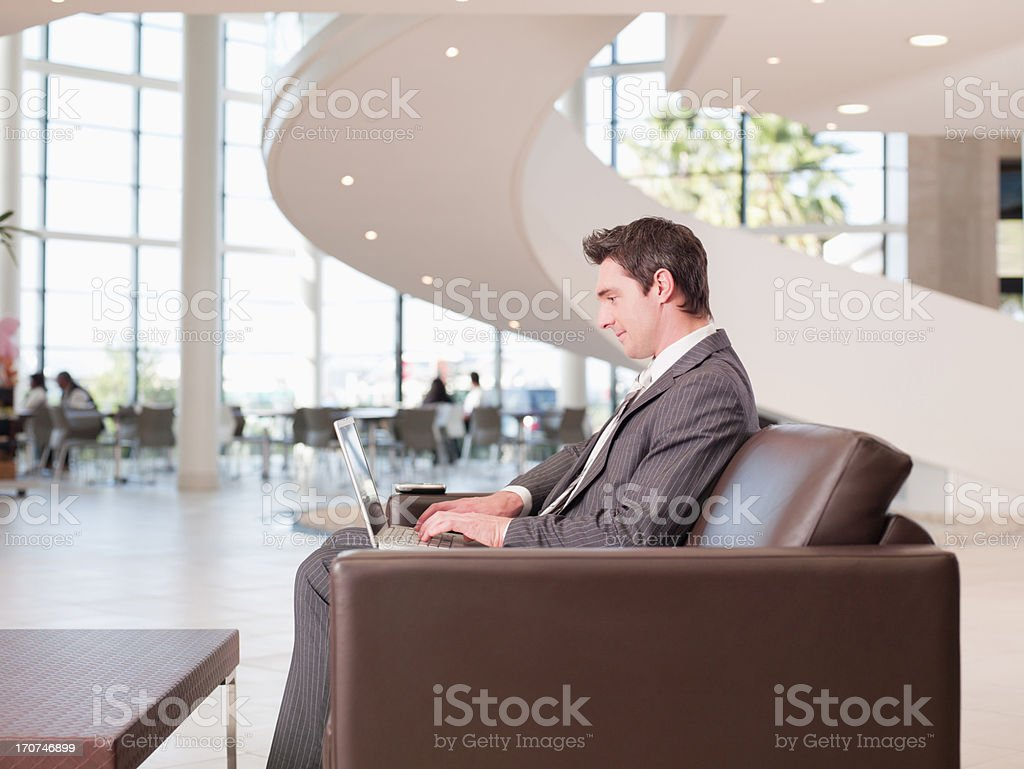 Businessman working in office waiting area royalty-free stock photo