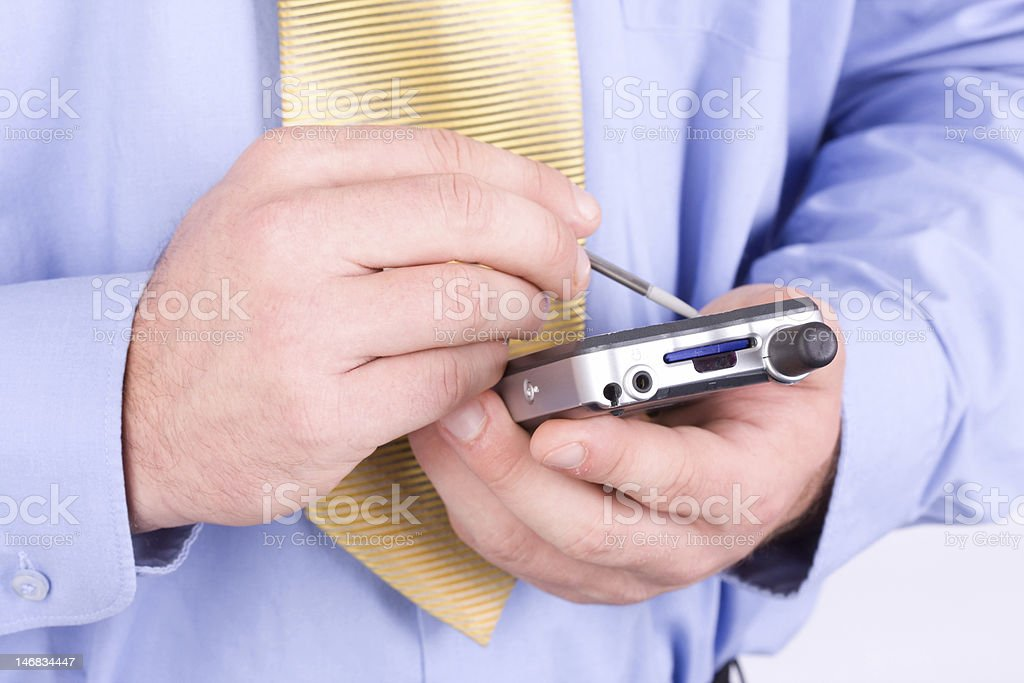 Businessman working in PDA royalty-free stock photo