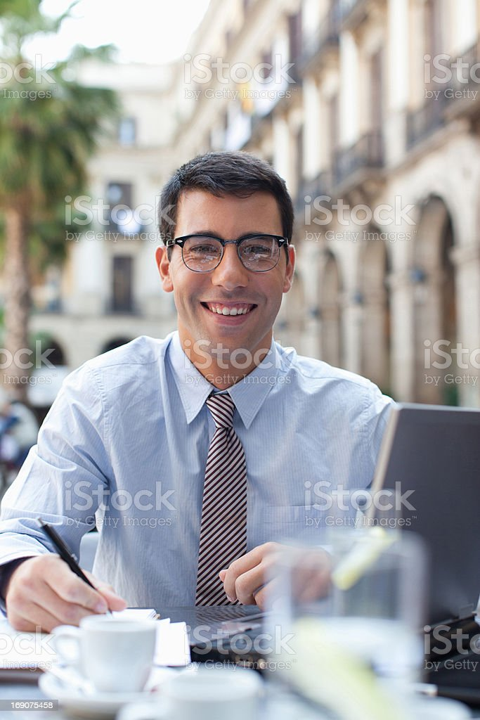 Businessman working in sidewalk cafe royalty-free stock photo