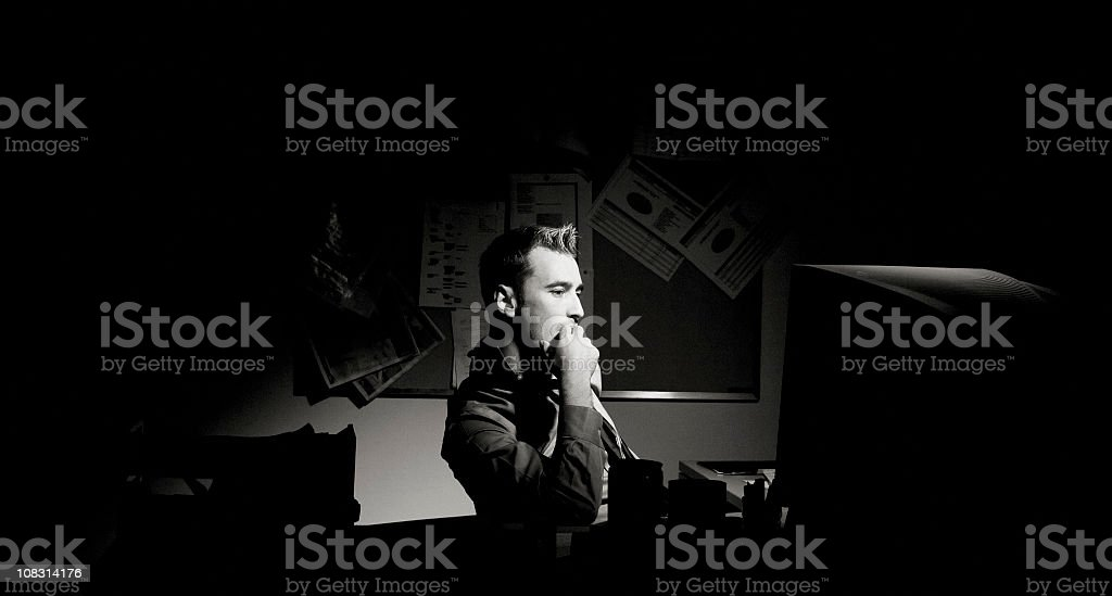 Businessman working late at the office stock photo
