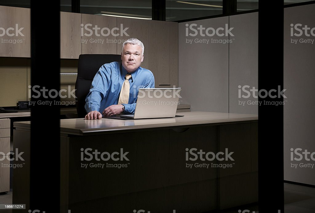 Businessman working late royalty-free stock photo