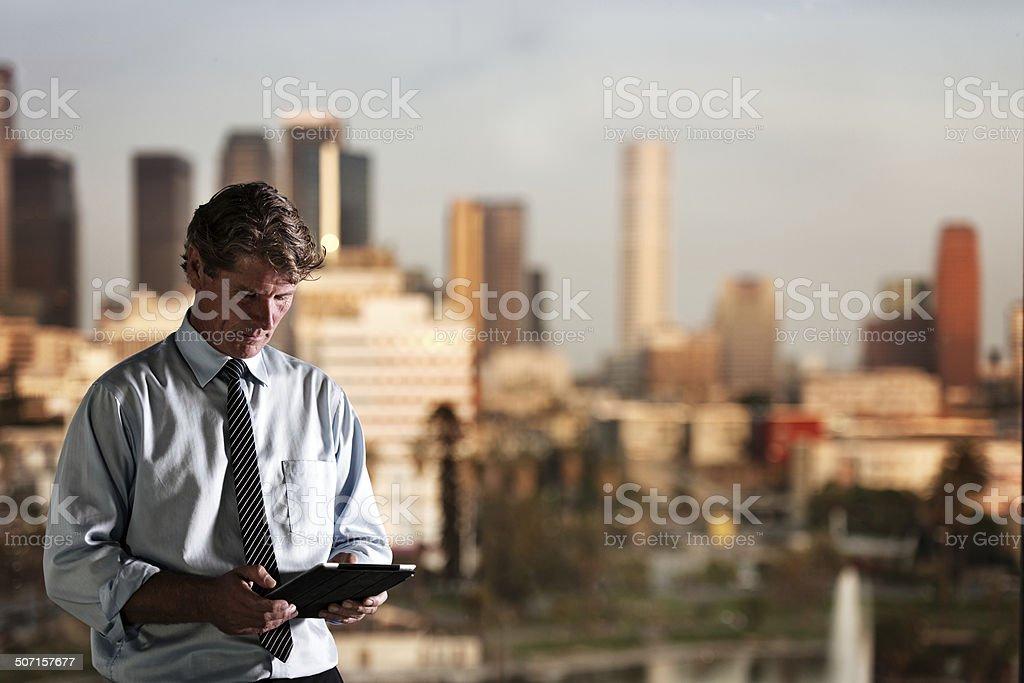 Businessman working late stock photo