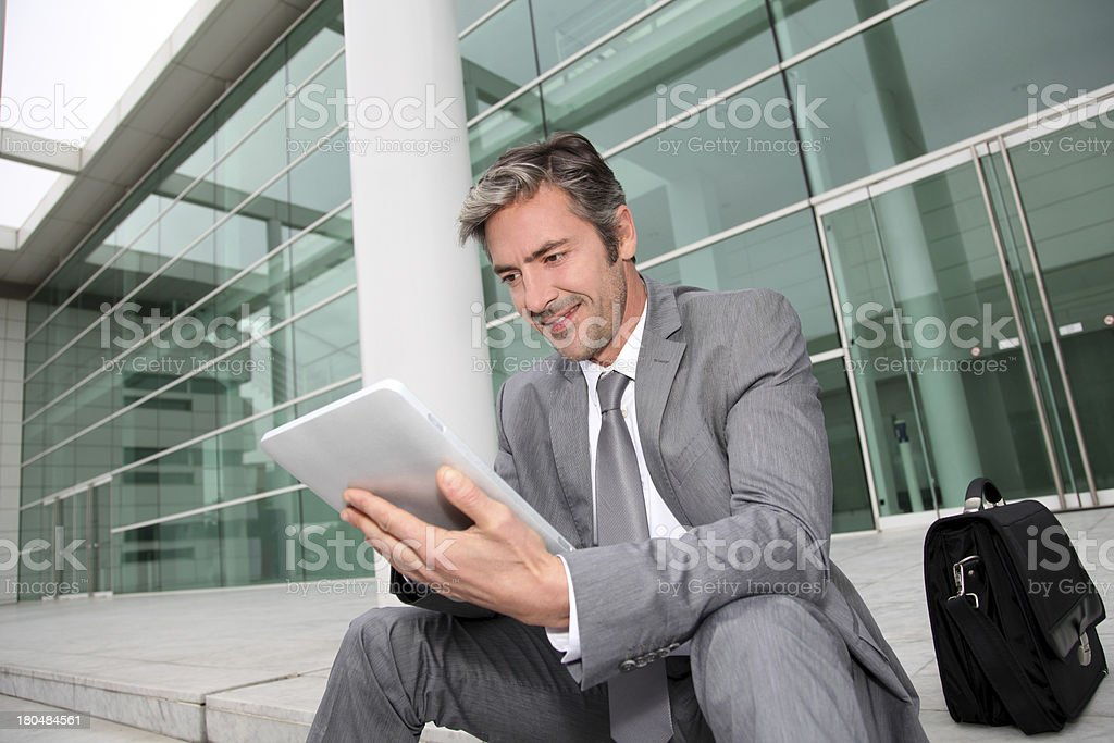 Businessman working  near a modern building royalty-free stock photo
