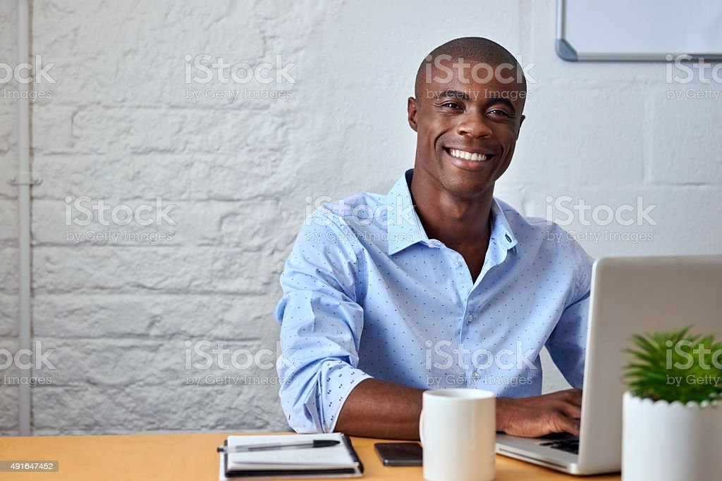 businessman working office laptop portrait stock photo