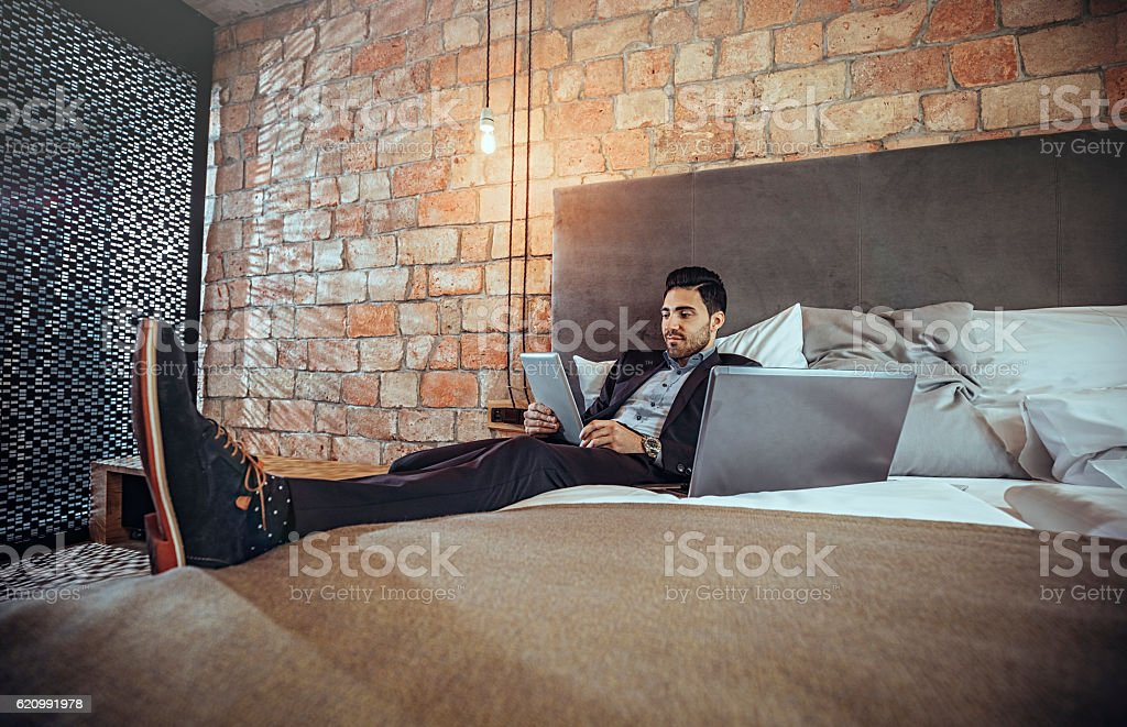 Businessman working on a business trip at the hotel room stock photo