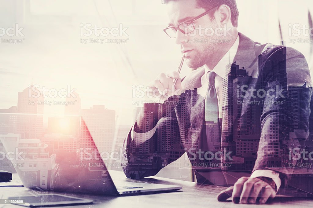 Businessman working on a laptop. stock photo