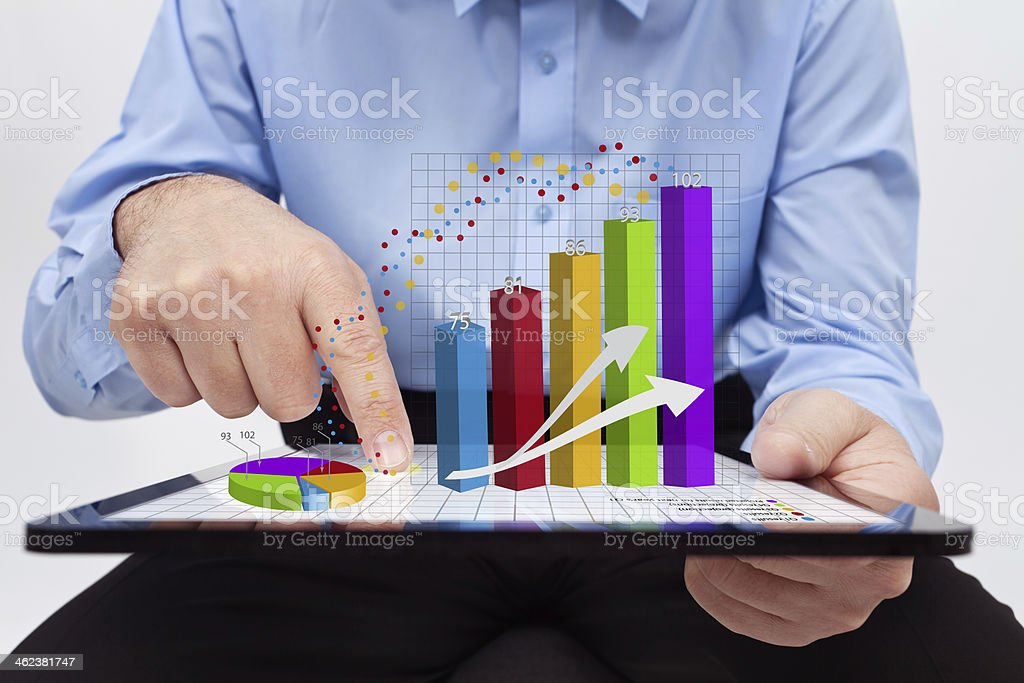 Businessman working on annual reports stock photo