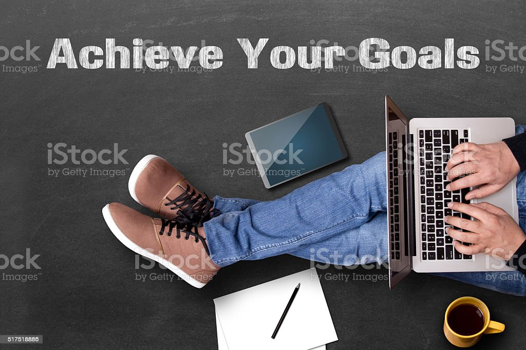 Businessman working on blackboard to achieve his goals stock photo