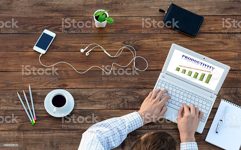 Businessman Working on Computer at Vintage Wood Table Top View stock photo