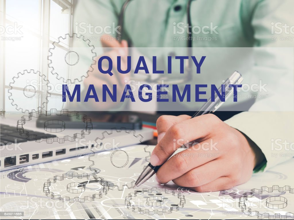 businessman working on desk office and quality management text. stock photo