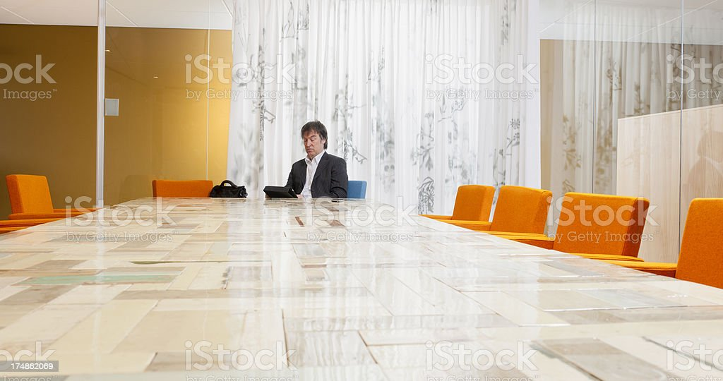 businessman working on digital tablet in board room stock photo