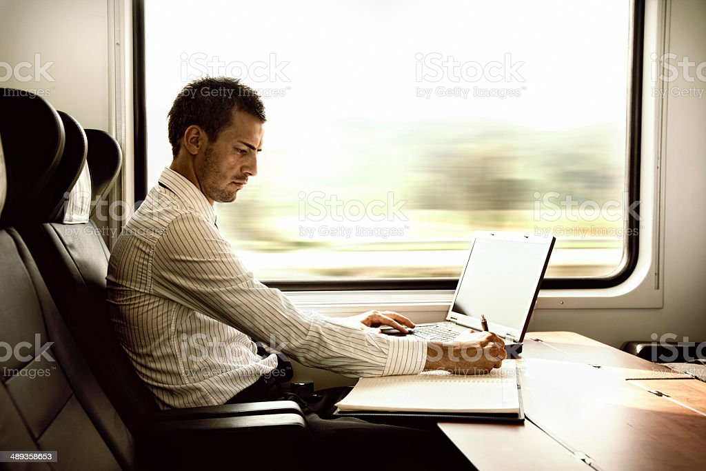 businessman working on high speed train stock photo