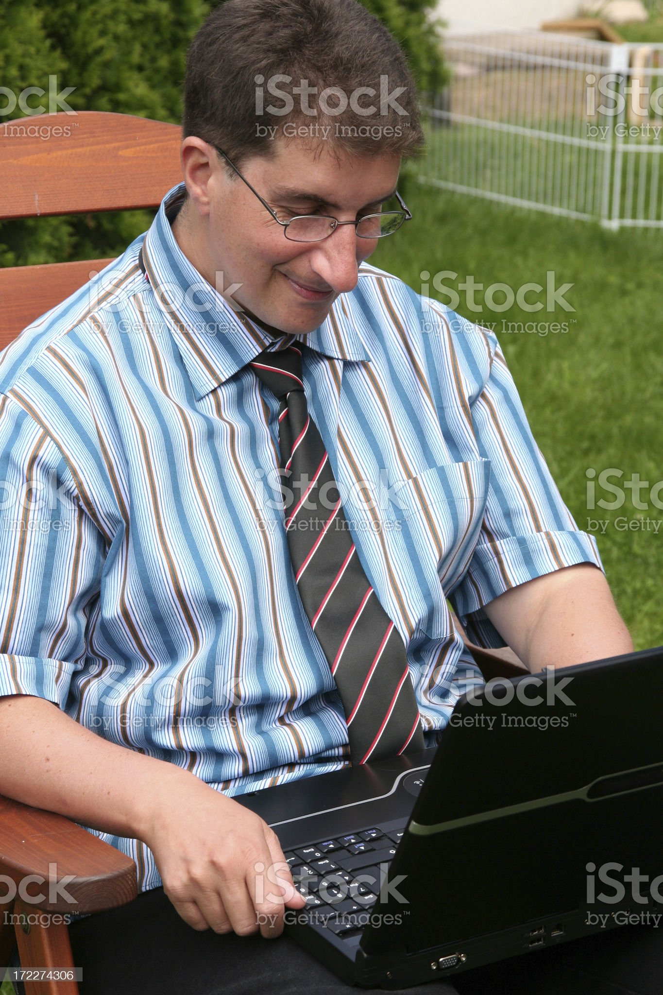 businessman working on his laptop in nature royalty-free stock photo