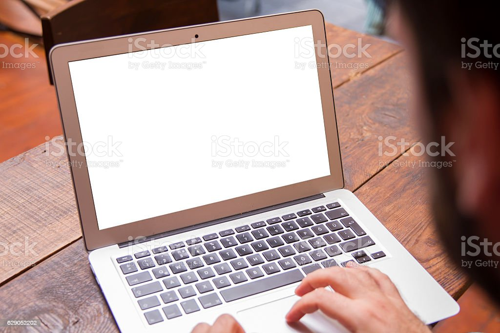Businessman working on his laptop with copy space stock photo