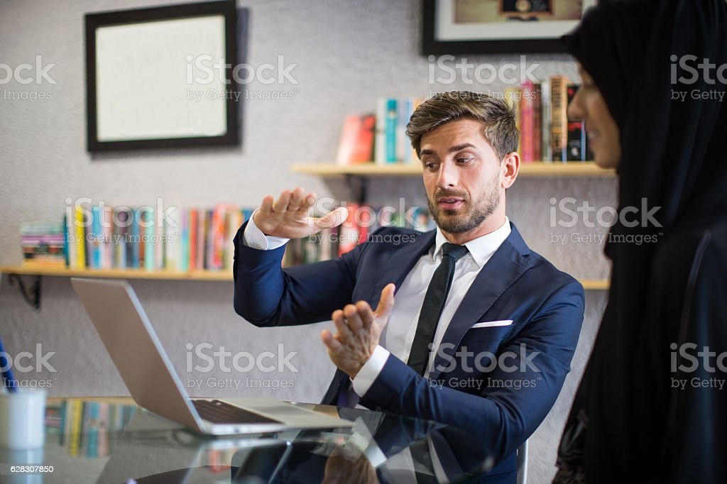Businessman working on his project plans with a colleague. stock photo