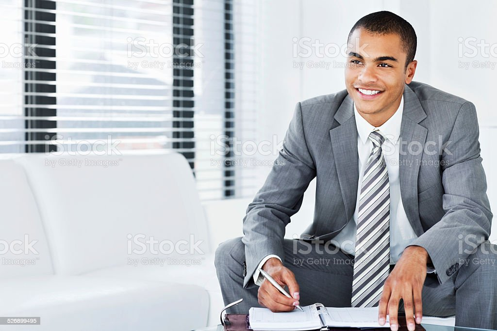 Businessman Working on His Schedule stock photo